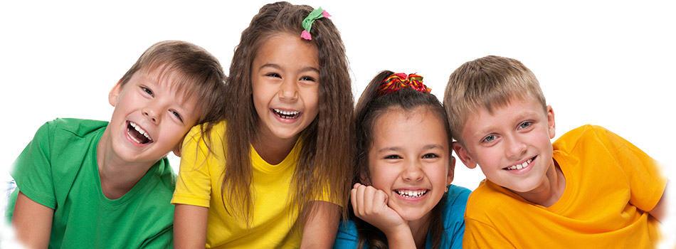 smiling ethnic children at dentist